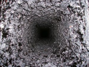 A flue coated in tar and creosote