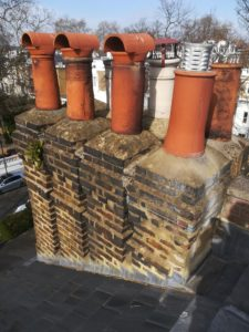 Double banked chimneys for fireplace
